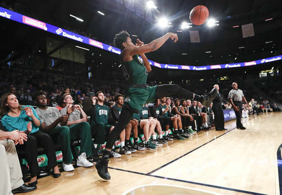 Ohio guard Mike Laster (24) keeps the ball in bounds in the second half of an NCAA college basketball game against Georgia Tech Friday, Nov. 18, 2016, in Atlanta. Ohio won 67-61. (AP Photo/John Bazemore)