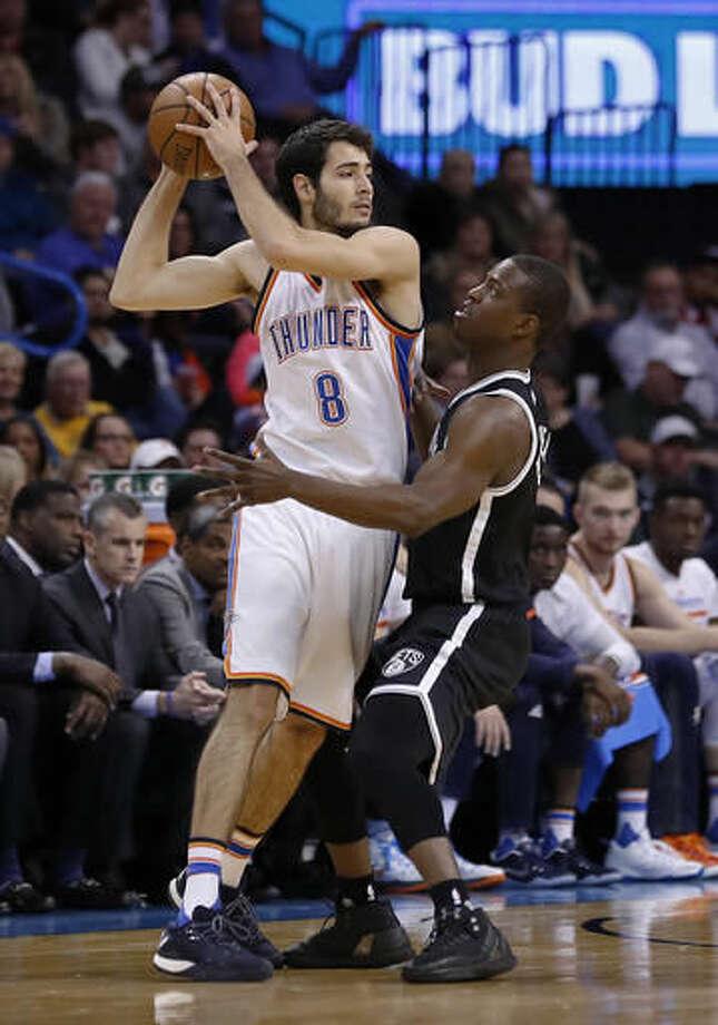 Brooklyn Nets guard Sean Kilpatrick defends Oklahoma City Thunder guard Alex Abrines (8) during the first half of an NBA basketball game in Oklahoma City, Friday, Nov. 18, 2016. (AP Photo/Alonzo Adams)