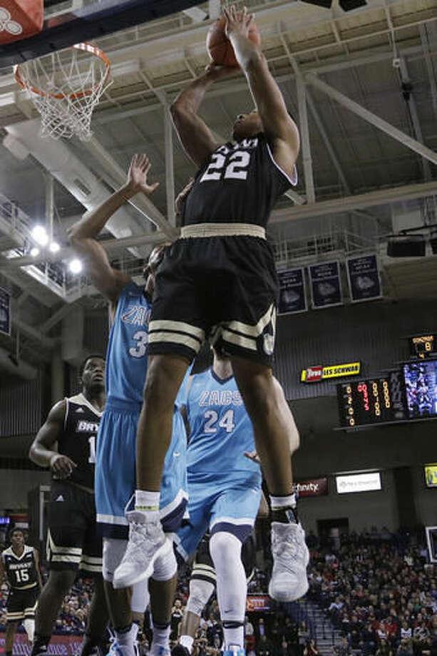 Bryant forward Dan Garvin (22) shoots against Gonzaga forward Johnathan Williams (3) during the first half of an NCAA college basketball game in Spokane, Wash., Friday, Nov. 18, 2016. (AP Photo/Young Kwak)