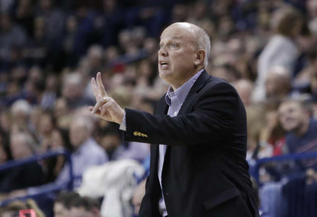 Bryant coach Tim O'Shea gestures to his team during the first half of an NCAA college basketball game against Gonzaga in Spokane, Wash., Friday, Nov. 18, 2016. (AP Photo/Young Kwak)