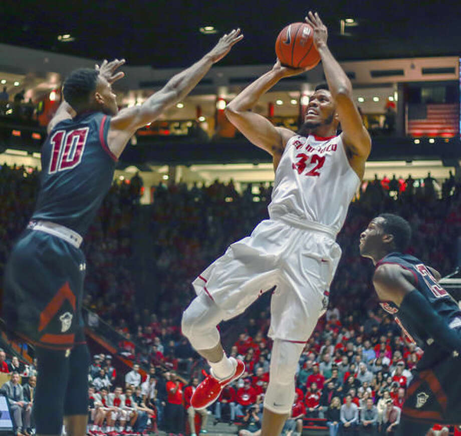 New Mexico's Tim Williams (32) shoots over New Mexico State's Jemerrio Jones (10) flanked by Sidy N'Dir (13) during the first half of an NCAA college basketball game in Albuquerque, N.M., Friday, Nov. 18, 2016. (AP Photo/Juan Antonio Labreche)
