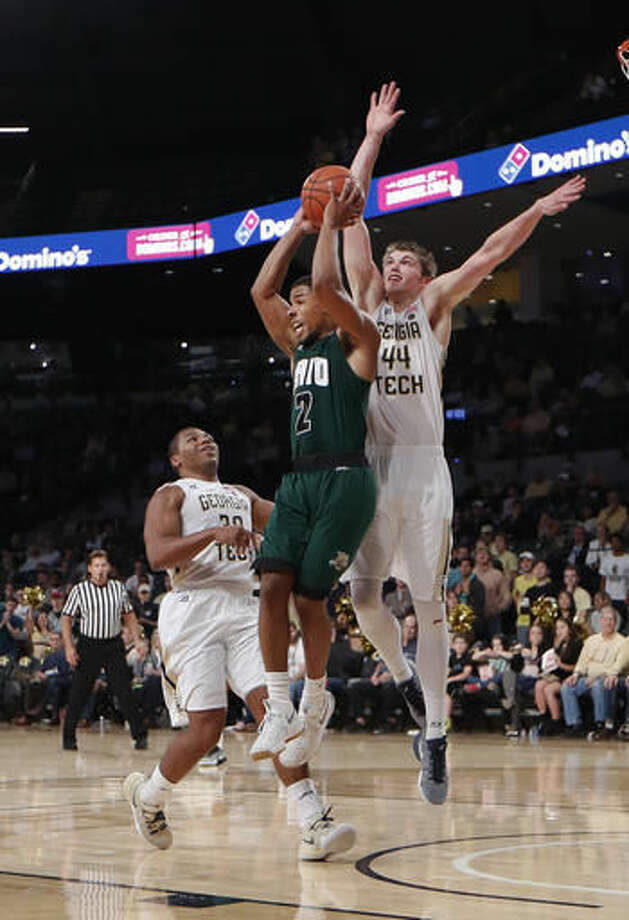 Ohio guard Jaaron Simmons (2) grabs a rebound against Georgia Tech center Ben Lammers (44) in the second half of an NCAA college basketball game Friday, Nov. 18, 2016, in Atlanta. Ohio won 67-61. (AP Photo/John Bazemore)