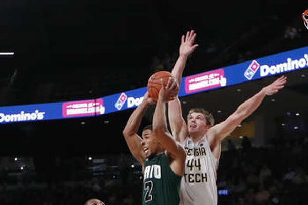 Ohio guard Jaaron Simmons (2) grabs a rebound against Georgia Tech center Ben Lammers (44) in the second half of an NCAA college basketball game Friday, Nov. 18, 2016, in Atlanta. Ohio won 67-61. (AP Photo/John Bazemore)