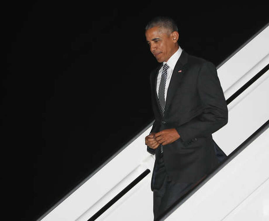 President Barack Obama walks down the stairs from Air Force One during his arrival at Jorge Chavez International Airport in Lima, Peru, Friday, Nov. 18, 2016. Obama traveled to South America to attend the annual Asia-Pacific Economic Cooperation (APEC) forum. (AP Photo/Pablo Martinez Monsivais)