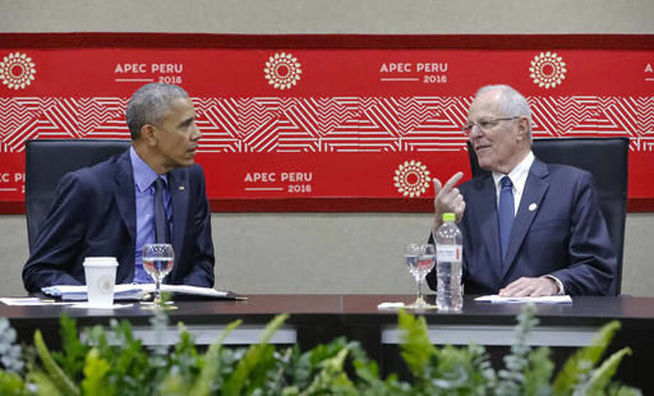 US President Barack Obama meets with Peru's President Pedro Pablo Kuczynski at the Asia-Pacific Economic Cooperation (APEC) in Lima, Peru, Saturday, Nov. 19, 2016. Obama will close a three-nation, post-U.S. election tour the same way he opened it: by reassuring leaders from around the world that U.S. democracy isn't broken and that everything will be fine when Republican Donald Trump succeeds him next year. (AP Photo/Pablo Martinez Monsivais)