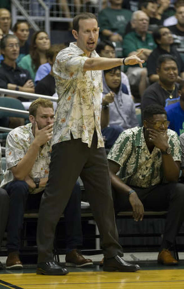 Hawaii head coach Eran Ganot points to one of his players as his team takes on North Carolina in the first half of an NCAA college basketball game, Friday, Nov. 18, 2016, in Honolulu. (AP Photo/Eugene Tanner)