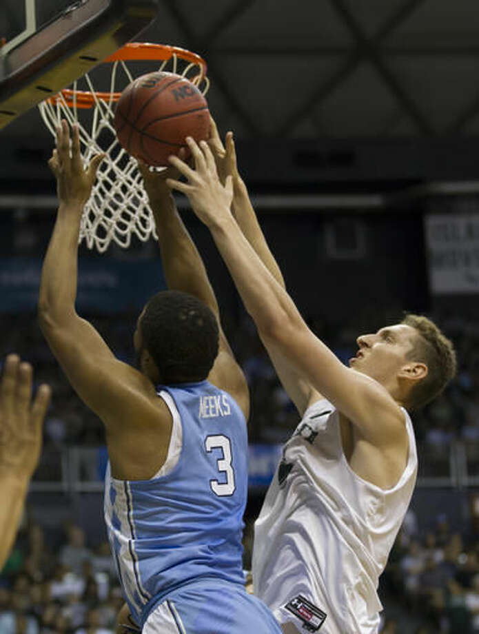 Hawaii center Ido Flaisher, right, attempts to block a shot by North Carolina forward Kennedy Meeks (3) in the first half of an NCAA college basketball game, Friday, Nov. 18, 2016, in Honolulu. (AP Photo/Eugene Tanner)