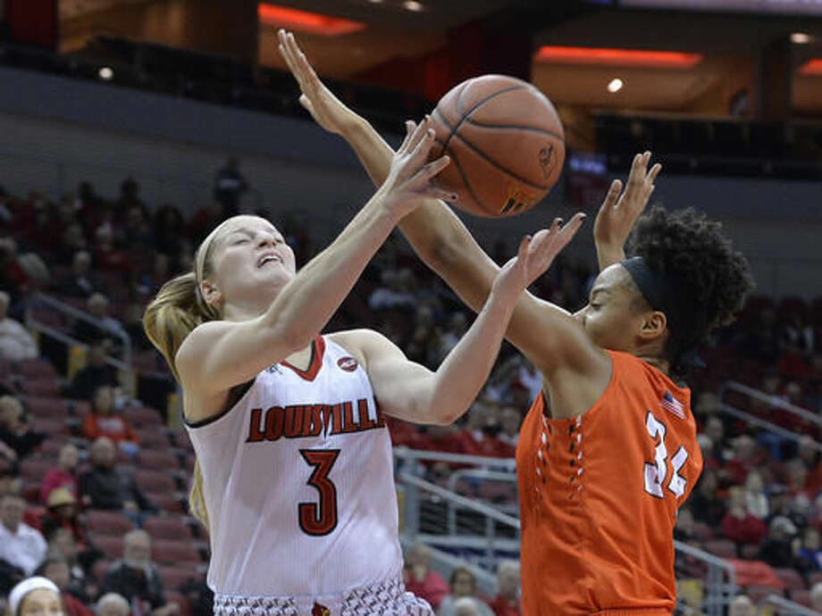 Louisville's Sam Fuehring (3) is fouled by Bowling Green's Ashley Tunstall (34) during the first half of an NCAA college basketball game, Saturday, Nov. 19, 2016, in Louisville, Ky. (AP Photo/Timothy D. Easley)