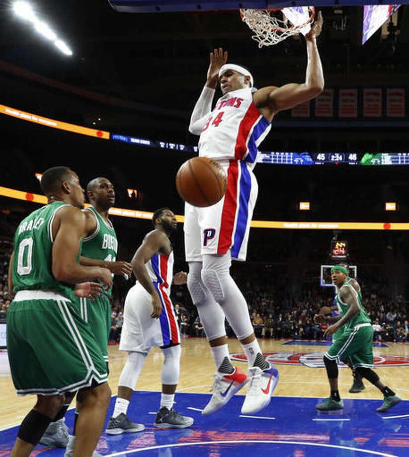 Detroit Pistons forward Tobias Harris (34) dunks against the Boston Celtics during the first half of an NBA basketball game in Auburn Hills, Mich., Saturday, Nov. 19, 2016. (AP Photo/Paul Sancya)