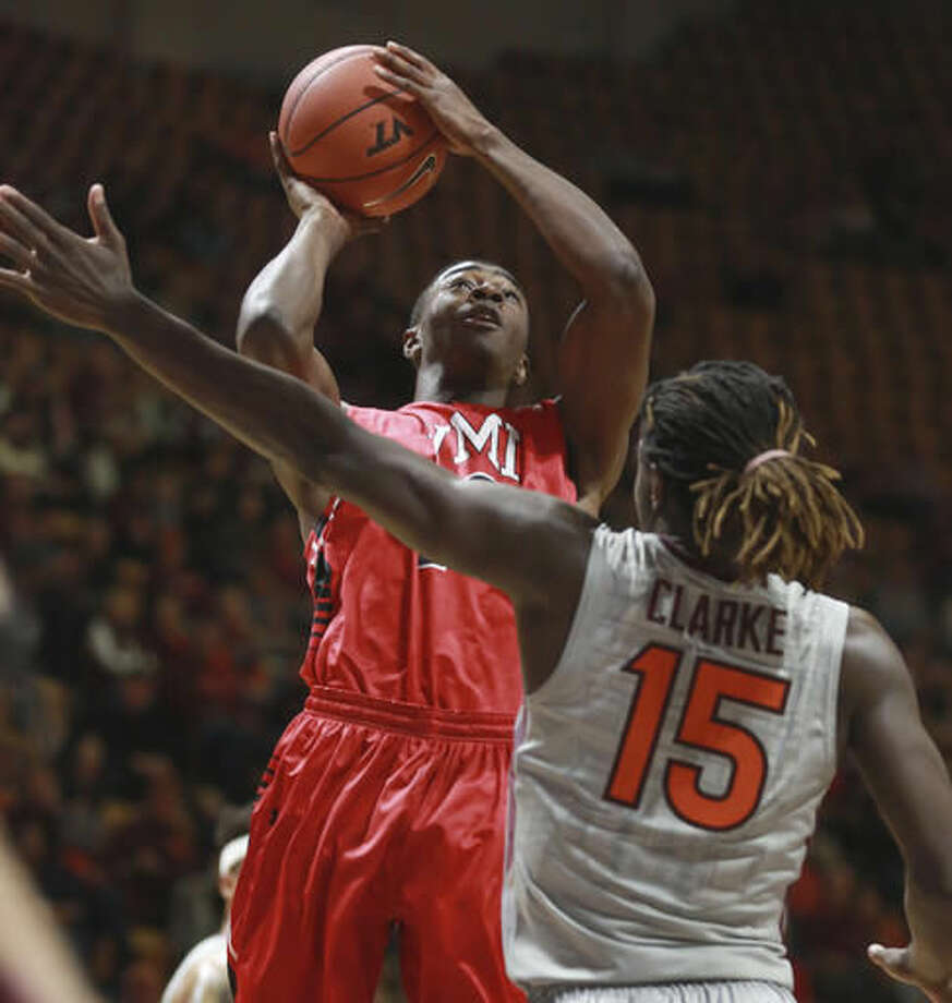 Virginia Military's Trey Chapman (15) shoots over the defense of Virginia Tech's Chris Clarke (15)in the first half of an NCAA college basketball game, Saturday, Nov. 19, 2016 in Blacksburg, Va. (Matt Gentry/The Roanoke Times via AP)
