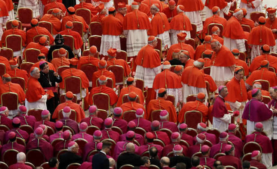 Cardinals and bishops wait for the start of a consistory in St. Peter's Basilica at the Vatican, Saturday, Nov. 19, 2016. Pope Francis has named 17 new cardinals, 13 of them under age 80 and thus eligible to vote in a conclave to elect his successor.(AP Photo/Gregorio Borgia, pool )