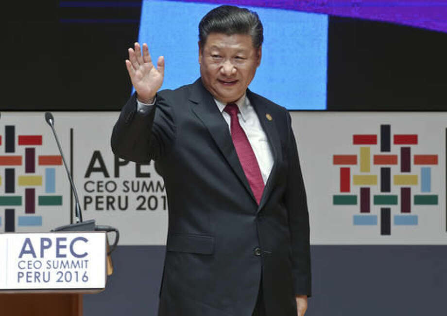China's President Xi Jinping waves after speaking at the CEO summit during the annual Asia Pacific Economic Cooperation (APEC) forum in Lima, Peru, Saturday, Nov. 19, 2016. (AP Photo/Esteban Felix)