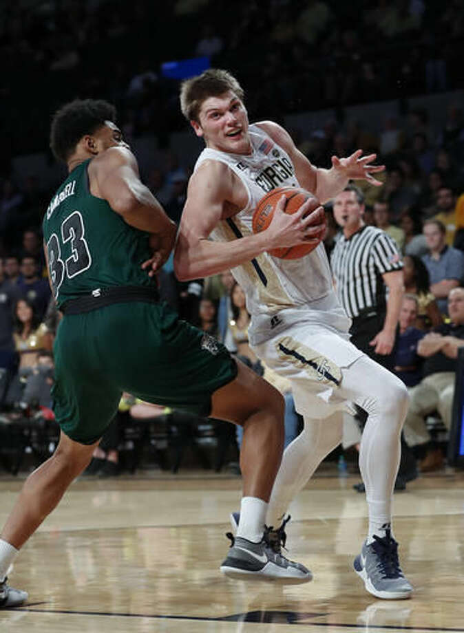 Georgia Tech center Ben Lammers (44) drives against Ohio forward Antonio Campbell (33) in the first half of an NCAA college basketball game Friday, Nov. 18, 2016, in Atlanta. (AP Photo/John Bazemore)