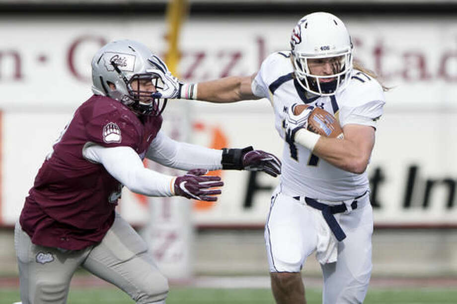 Montana State running back Chad Newell (17) breaks a Montana tackle as he rushes in the first half of an NCAA college football game Saturday, Oct. 19, 2016, in Missoula, Mont. (AP Photo/Patrick Record)