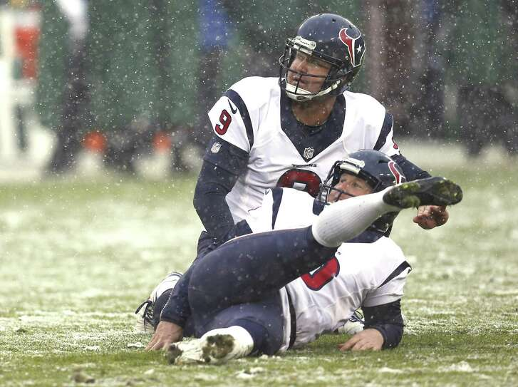 Houston Texans kicker Nick Novak (8) slips to the turf as he misses an extra point against the Green Bay Packers during the fourth quarter at Lambeau Field on Dec. 4, 2016, in Green Bay, Wis.