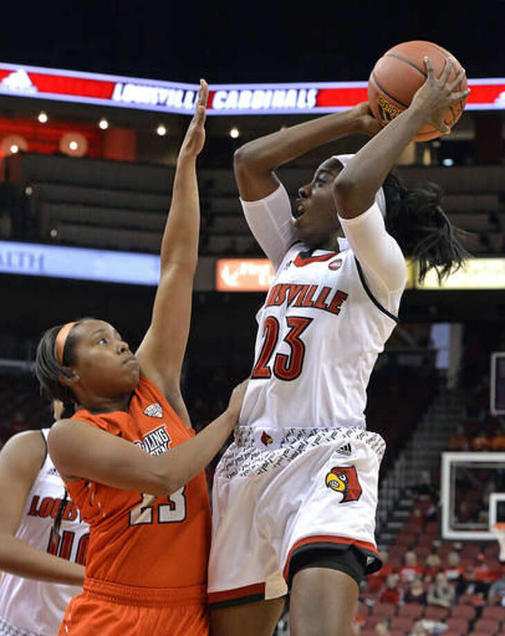 Louisville's Jazmine Jones (23) shoots over the defense of Bowling Green's Rion Thompson (23) during the second half of an NCAA college basketball game, Saturday, Nov. 19, 2016, in Louisville, Ky. Louisville won 83-58. (AP Photo/Timothy D. Easley)