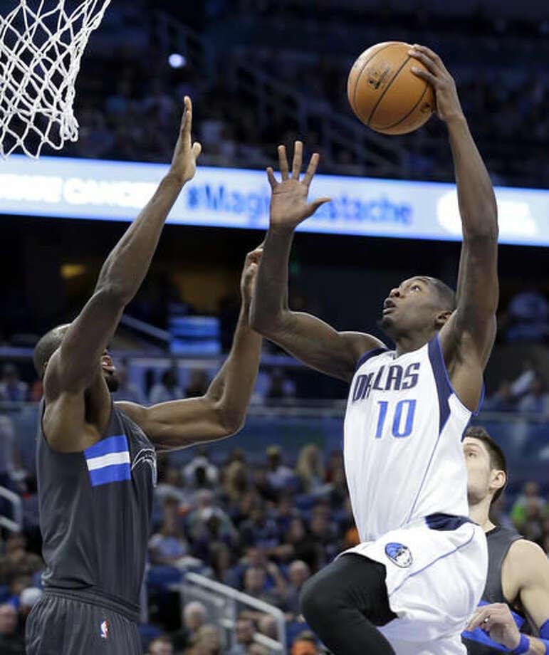 Dallas Mavericks' Dorian Finney-Smith (10) takes a shot over Orlando Magic's Serge Ibaka, left, during the first half of an NBA basketball game, Saturday, Nov. 19, 2016, in Orlando, Fla. (AP Photo/John Raoux)