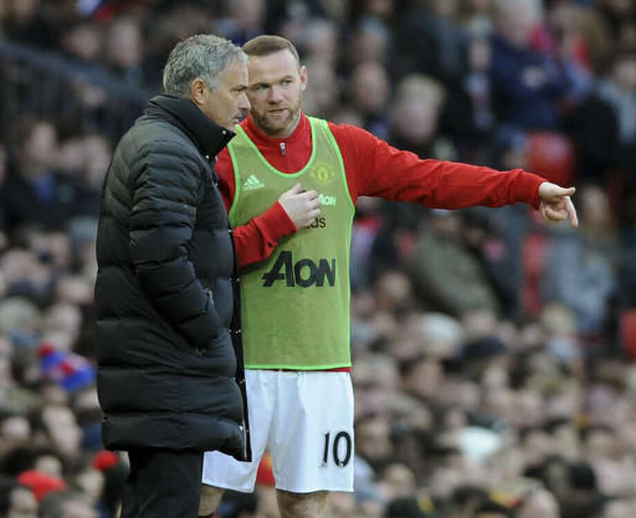 Manchester United's Wayne Rooney, right, talks to Manchester United manager Jose Mourinho before coming on as a substitute during the English Premier League soccer match between Manchester United and Arsenal at Old Trafford in Manchester, England, Saturday, Nov. 19, 2016. (AP Photo/Rui Vieira)