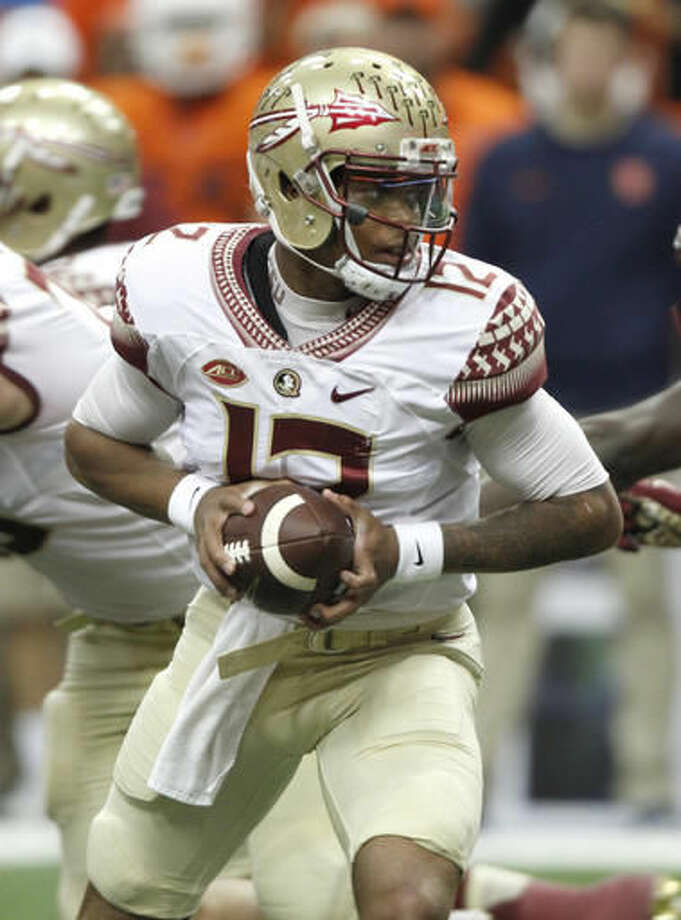Florida State's Deondre Francois looks to hand off the ball in the first quarter of an NCAA college football game against Syracuse in Syracuse, N.Y., Saturday, Nov. 19, 2016. (AP Photo/Nick Lisi)