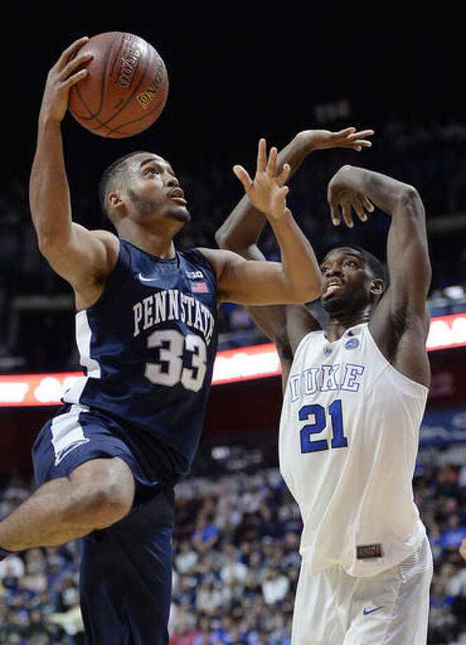 Penn State's Shep Garner shoots as Penn State's Isaiah Washington, right, defends in the first half of an NCAA college basketball game, Saturday, Nov. 19, 2016, in Uncasville, Conn. (AP Photo/Jessica Hill)