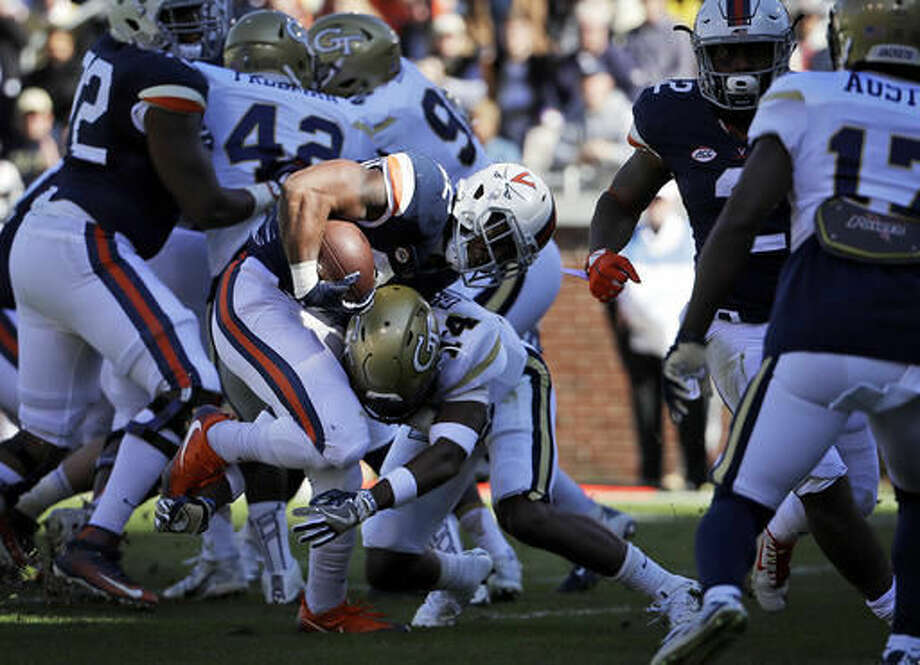 Virginia's Daniel Hamm, left, runs the ball for a touchdown past Georgia Tech's Corey Griffin, right, in the second quarter of an NCAA college football game in Atlanta, Saturday, Nov. 19, 2016. (AP Photo/David Goldman)