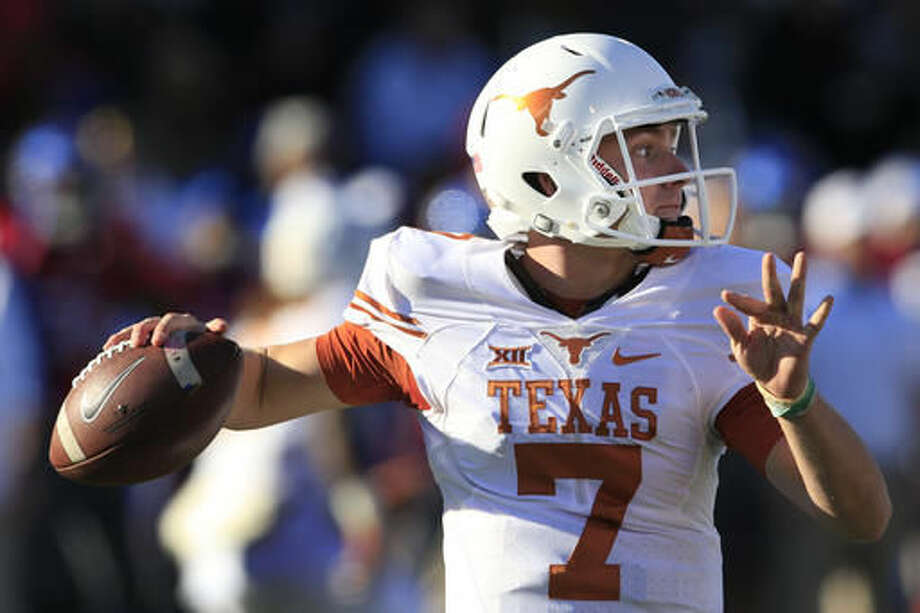 Texas quarterback Shane Buechele passes to a teammate during the first half of an NCAA college football game against Kansas in Lawrence, Kan., Saturday, Nov. 19, 2016. (AP Photo/Orlin Wagner)