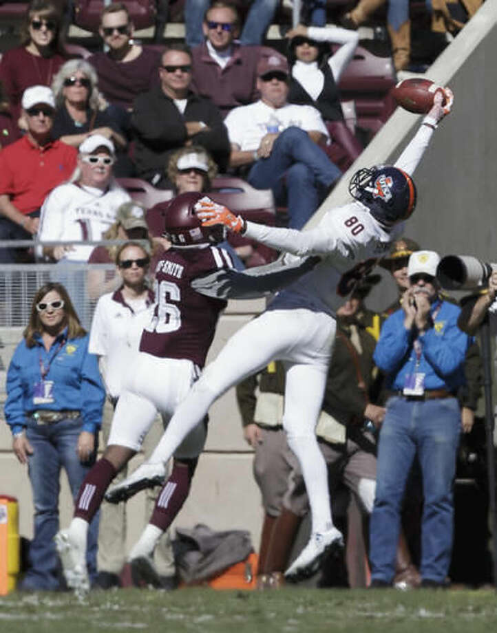 UTSA wide receiver Josh Stewart (80) makes a one-handed catch over Texas A&M defensive back DeShawn Capers-Smith (26) for a touchdown during the second quarter of an NCAA college football game Saturday, Nov. 19, 2016, in College Station, Texas. (AP Photo/Sam Craft)
