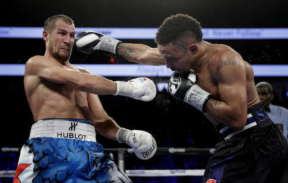 Sergey Kovalev, left, of Russia, backs away from a punch from Andre Ward fight during their light heavyweight boxing match, Saturday, Nov. 19, 2016, in Las Vegas. (AP Photo/John Locher)