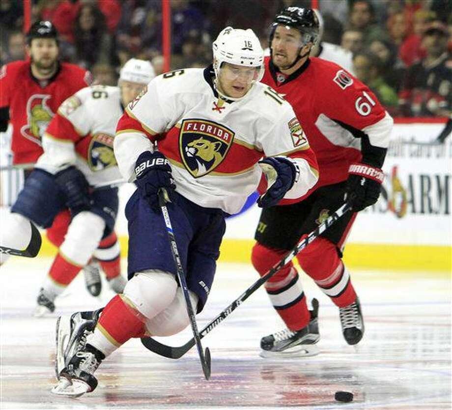 Florida Panthers' Aleksander Barkov (16) skates past Ottawa Senators' Mark Stone (61) during the first period of an NHL hockey game in Ottawa, Ontario, Saturday, Nov. 19, 2016. (Fred Chartrand/The Canadian Press via AP)