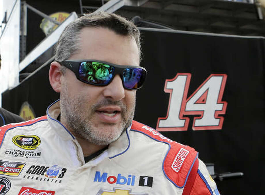 Tony Stewart heads to the hauler after the NASCAR Sprint Cup Series Auto Racing practice Saturday, Nov. 19, 2016, in Homestead, Fla. (AP Photo/Alan Diaz)