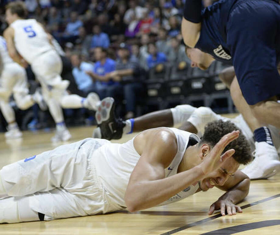 Duke's Chase Jeter reacts after injuring his ankle in the first half of an NCAA college basketball game against Penn State, Saturday, Nov. 19, 2016, in Uncasville, Conn. (AP Photo/Jessica Hill)