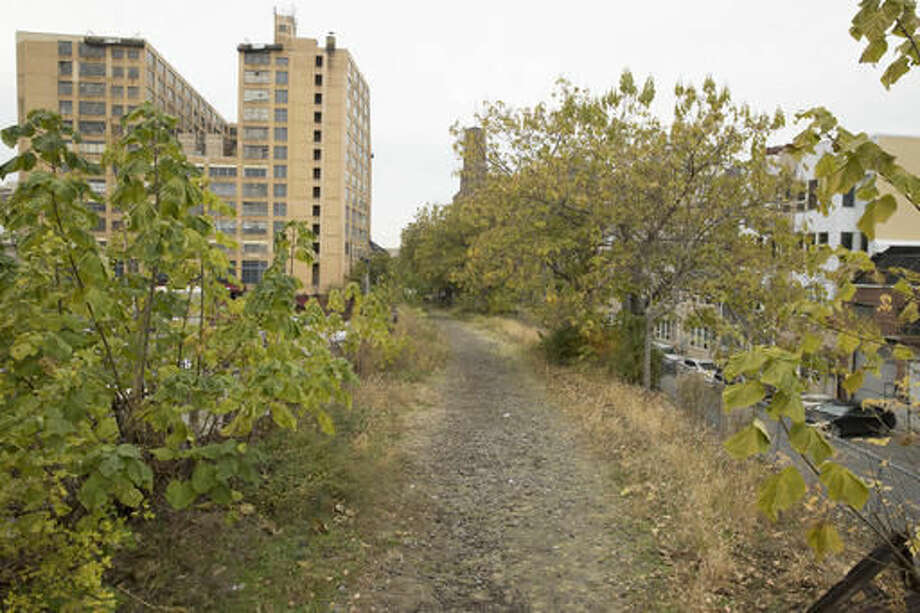 In this Monday, Nov. 14, 2016 photo, shown is the Reading Railroad viaduct in Philadelphia. After over a decade of planning, Philadelphia is scheduled to start construction on the Viaduct Rail Park, transforming the rusting, overgrown and abandoned rail line into an elevated park. It will join the likes of New York City's High Line, and officials say it will transform the way Philadelphians move through the city. (AP Photo/Matt Rourke)