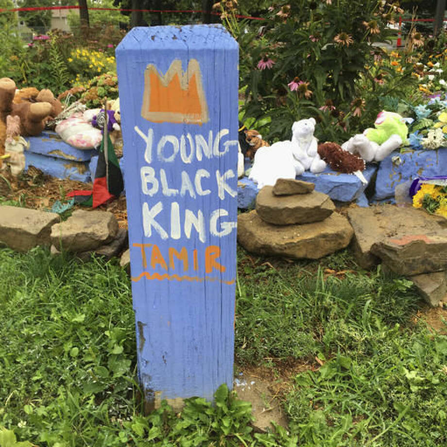 """FILE - In this Sept. 14, 2016, file photo, """"Young Black King Tamir"""" is written on a wooden post near a makeshift memorial at the gazebo where 12-year-old Tamir Rice was fatally shot, outside the Cudell Recreation Center in Cleveland. Samaria Rice, whose 12-year-old son Tamir was fatally shot by a white Cleveland police officer on Nov. 22, 2014, told The Associated Press on Wednesday, Nov. 16, 2016, that she's trying to find a path forward for her family, and working to create a foundation in Tamir's name using part of a $6 million settlement with the city. (AP Photo/Mark Gillispie, File)"""