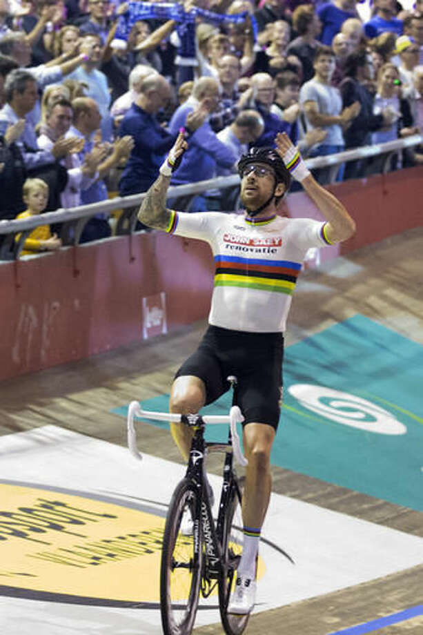 Former Tour de France winner and Olympic Gold medallist Britain's Bradley Wiggins celebrates winning the six day race at 't Kuipke velodrome in Ghent, Belgium, Sunday, Nov. 20, 2016. The Ghent Six Day event was the first bike race that his father took him to as a child, long before he would become the most decorated Olympian in British history. (AP Photo/Peter Dejong)