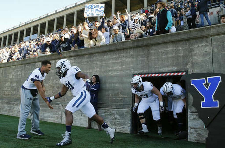 Yale players take the field before their NCAA football game against the Harvard at Harvard Stadium in Cambridge, Mass. Saturday, Nov. 19, 2016. (AP Photo/Winslow Townson)