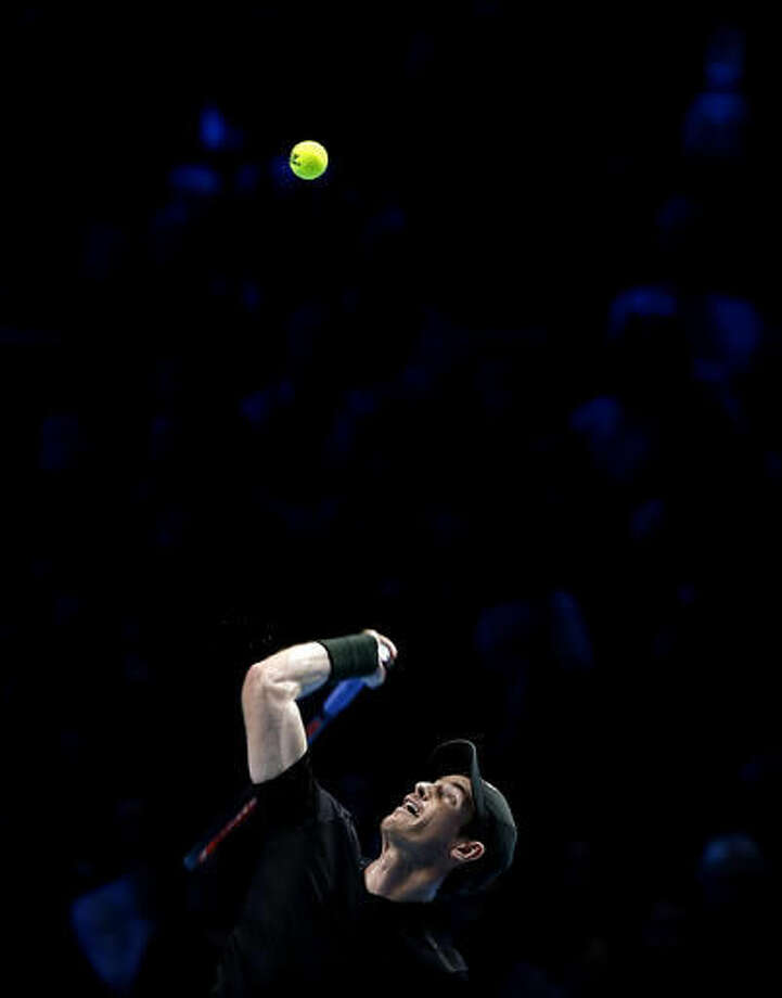 Andy Murray of Britain serves to Novak Djokovic of Serbia during their ATP World Tour Finals singles final tennis match at the O2 arena in London, Sunday, Nov. 20, 2016. (AP Photo/Alastair Grant)