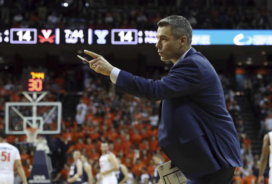 Virginia head coach Tony Bennett calls a play during an NCAA college basketball game against Yale in Charlottesville, Va., Sunday, Nov. 20, 2016. (Andrew Shurtleff/The Daily Progress via AP)