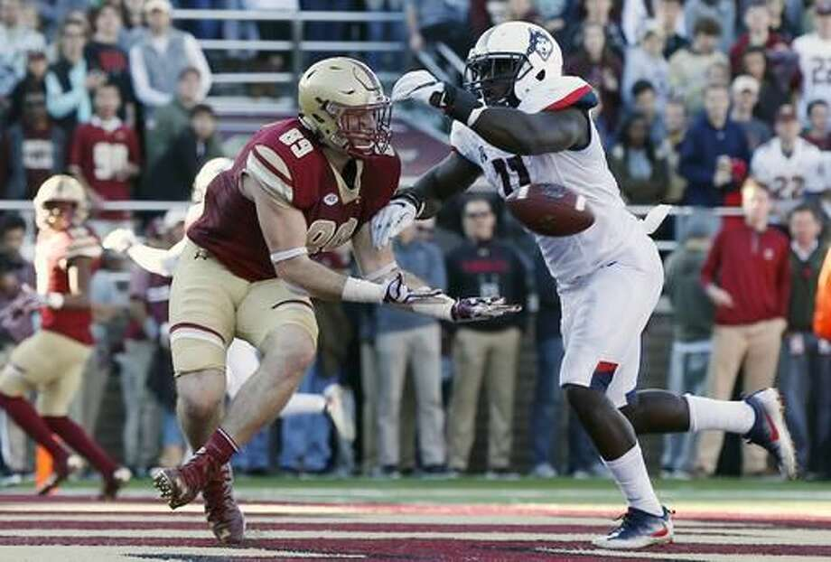 Boston College tight end Tommy Sweeney (89) misses a pass in the end zone under pressure from Connecticut running back Nate Hopkins (11) during the first half of an NCAA college football game in Boston, Saturday, Nov. 19, 2016. (AP Photo/Michael Dwyer)