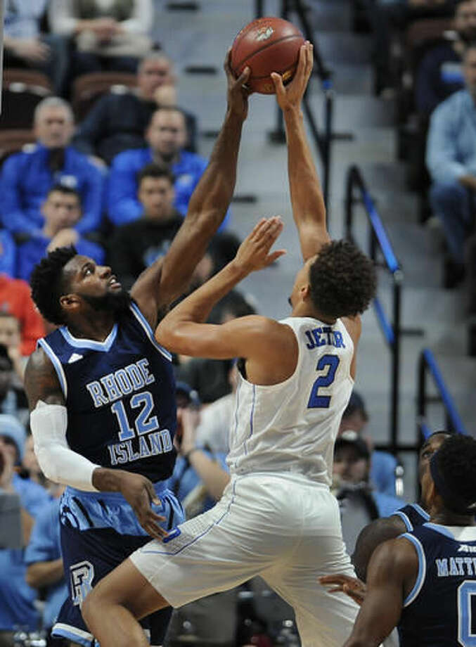 Rhode Island's Hassan Martin blocks a shot attempt by Duke's Chase Jeter in the first half of an NCAA college basketball game, Sunday, Nov. 20, 2016, in Uncasville, Conn. (AP Photo/Jessica Hill)