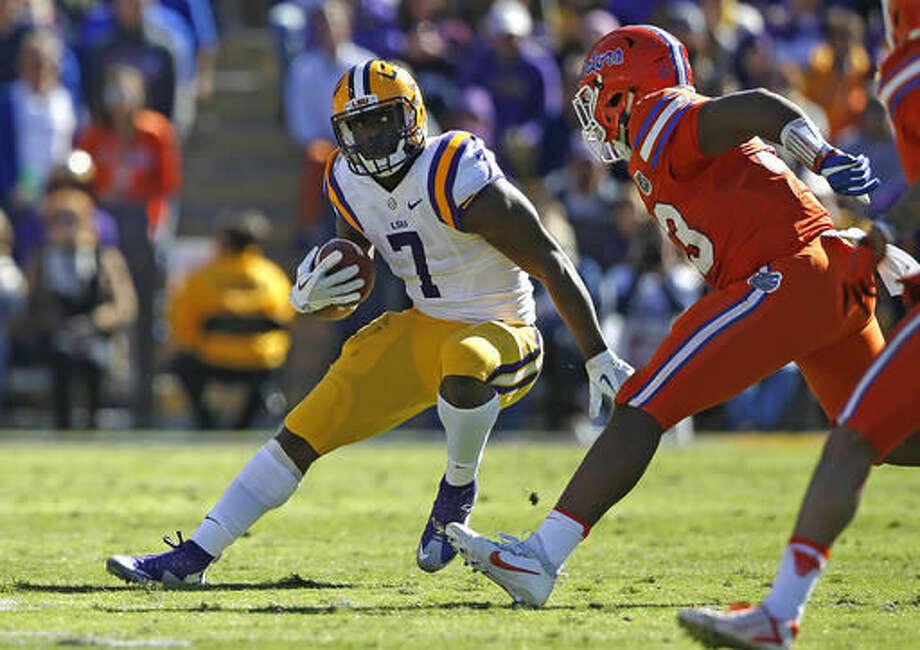 LSU running back Leonard Fournette (7) carries in the first half an NCAA college football game against Florida in Baton Rouge, La., Saturday, Nov. 19, 2016. (AP Photo/Gerald Herbert)