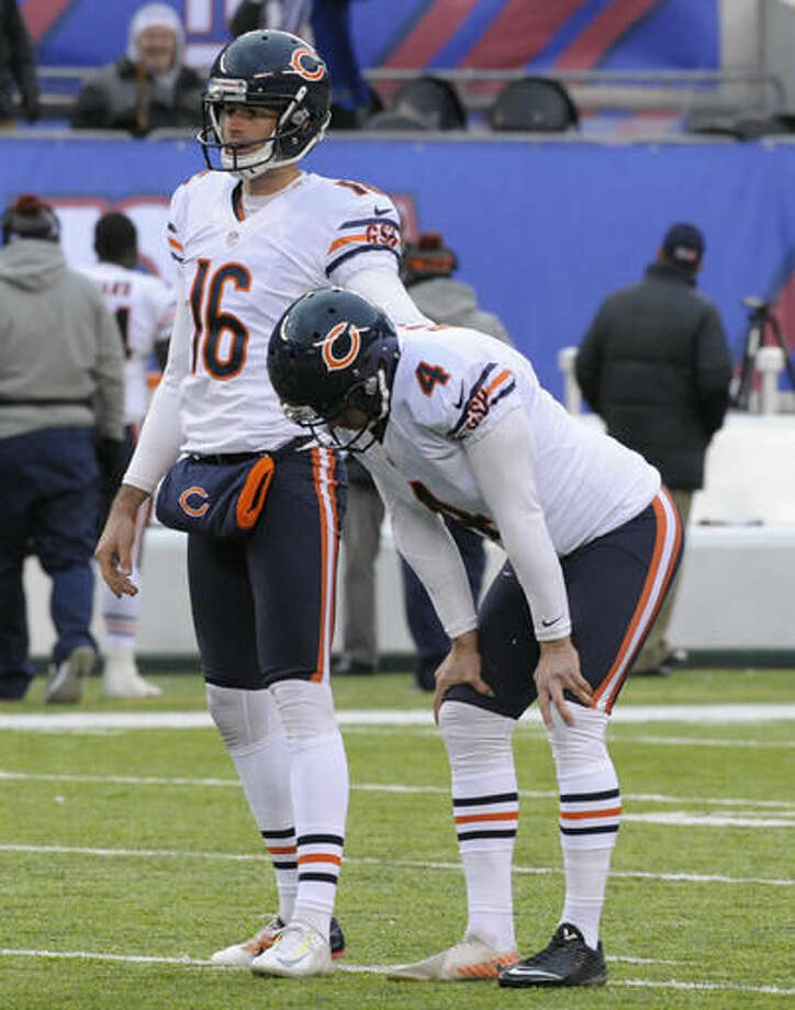 Chicago Bears kicker Connor Barth (4) and punter Pat O'Donnell (16) react after Barth missed a 51-yard field goal against the New York Giants during the fourth quarter of an NFL football game, Sunday, Nov. 20, 2016, in East Rutherford, N.J. (AP Photo/Bill Kostroun)