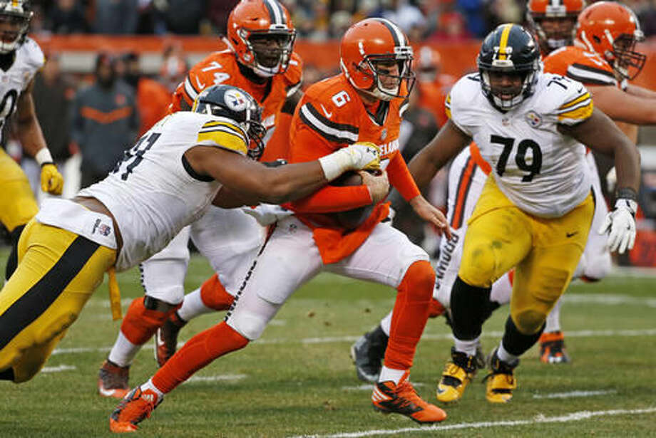 Cleveland Browns quarterback Cody Kessler (6) is tackled by Pittsburgh Steelers defensive end Stephon Tuitt (91) as scrambles out of the pocket during the second half of an NFL football game in Cleveland, Sunday, Nov. 20, 2016. (AP Photo/Ron Schwane)