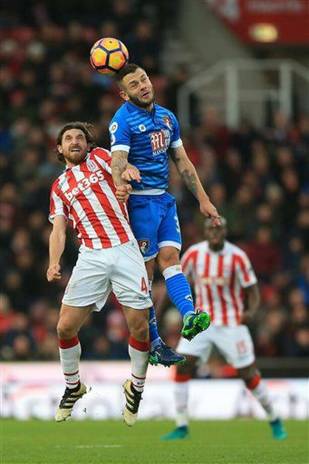 Stoke City's Joe Allen, left, and AFC Bournemouth's Jack Wilshere battle for the ball during the English Premier League soccer match at the Bet365 Stadium, Stoke-on-Trent, England, Saturday Nov. 19, 2016. (Nigel French/PA via AP)
