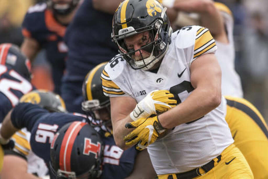 Iowa fullback Brady Ross (36) runs the ball during the second quarter of an NCAA college football game against Illinois, Saturday, Nov. 19, 2016, at Memorial Stadium in Champaign, Ill. (AP Photo/Bradley Leeb)