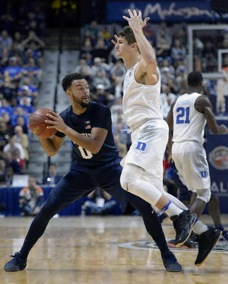Duke's Grayson Allen, right, guards, Penn State's Payton Banks, left, in the first half of an NCAA college basketball game, Saturday, Nov. 19, 2016, in Uncasville, Conn. (AP Photo/Jessica Hill)