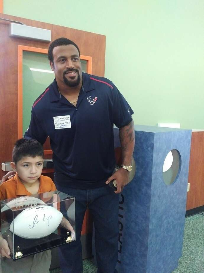 Texans tackle Duane Brown joined students Tuesday at Atherton Elementary in Houston and emphasized the importance of reading. Photo: Aaron Wilson / Houston Chronicle