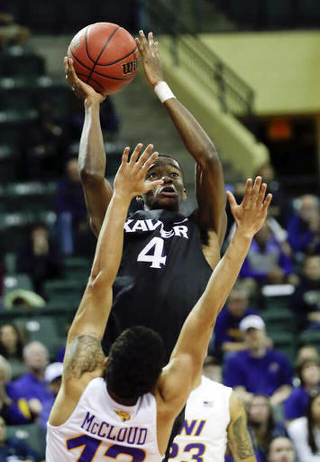 Xavier's Edmond Sumner (4) makes a shot over Northern Iowa's Juwan McCloud during the first half of an NCAA college basketball game at the Tire Pros Invitational tournament, Sunday, Nov. 20, 2016, in Lake Buena Vista, Fla. (AP Photo/John Raoux)