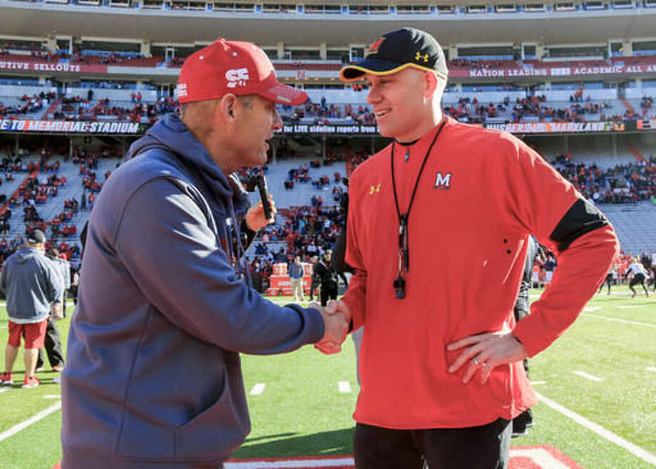 Nebraska head coach Mike Riley, left, and Maryland head coach DJ Durkin meet before an NCAA college football game in Lincoln, Neb., Saturday, Nov. 19, 2016. (AP Photo/Nati Harnik)