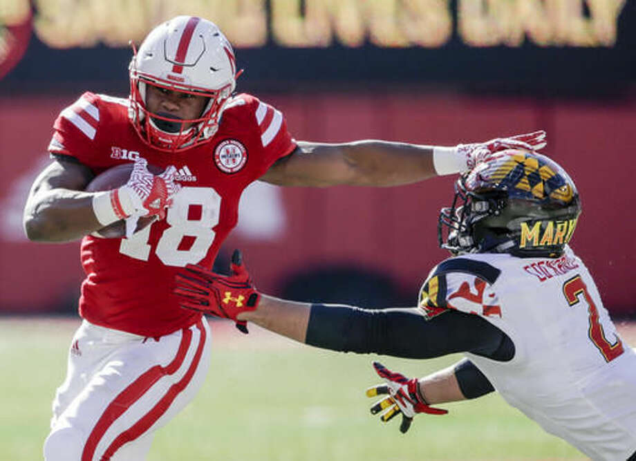 Nebraska running back Tre Bryant (18) runs past a tackle attempt by Maryland linebacker Shane Cockerille (2) during the first half of an NCAA college football game in Lincoln, Neb., Saturday, Nov. 19, 2016. (AP Photo/Nati Harnik)
