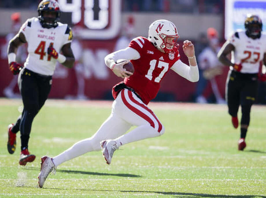 Nebraska quarterback Ryker Fyfe (17) carries the ball away from Maryland defensive lineman Jesse Aniebonam (41) and linebacker Jermaine Carter (23) during the first half of an NCAA college football game in Lincoln, Neb., Saturday, Nov. 19, 2016. (AP Photo/Nati Harnik)